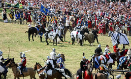 Knights fight. GRUNWALD - July 18: Battle of Grunwald 1410 reenactment. 1400 knights, 100 thousands viewers, 599th anniversary. Poland royalty free stock photo