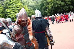 Knights before a fight. Preparation to knight's tournament royalty free stock photo