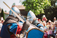 Knights In Fight With Sword. Restoration Of Knightly Battle Royalty Free Stock Image