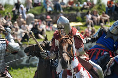 Knights fighting on horseback Stock Photos