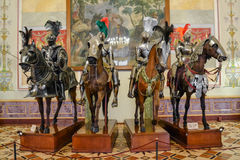 Knights in the Hermitage. Mounted knights on permanent display in the Hermitage Museum. Medieval  Museum. Knights in armor at an exhibition in St. Petersburg stock image