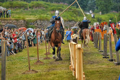 Knights on horseback compete in the tournament Stock Photography