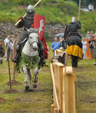 Knights on horseback compete in the tournament Stock Photo