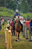 Knights on horseback compete in the tournament Stock Images