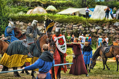 Knights on horseback compete in the tournament Stock Image