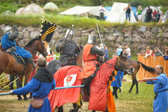 Knights on horseback compete in the tournament Stock Photos