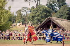 Knights Jousting. At Warwick Castle on horse back Stock Image