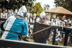 Knights. Minsk, Belarus - June 18, 2016: Festival The Age of chivalry - Knightly fight on swords Stock Photo