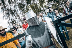 Knights. Minsk, Belarus - June 18, 2016: Festival The Age of chivalry - Knightly fight on swords Stock Photos