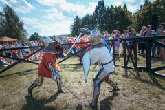 Knights. Minsk, Belarus - June 18, 2016: Festival The Age of chivalry - Knightly fight on swords Royalty Free Stock Image