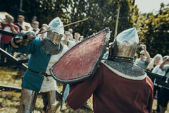 Knights. Minsk, Belarus - June 18, 2016: Festival The Age of chivalry - Knightly fight on swords Royalty Free Stock Photography