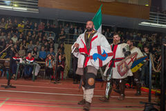 Knights. MOSCOW - DECEMBER 03, 2016: Armored fignters different countries, dressed as knights, carry the flags at the opening of the XI World championship in Royalty Free Stock Photo