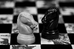 Knights on old chess board Royalty Free Stock Photography