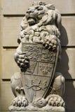 Königliche Löwe-Steinstatue Stockbilder