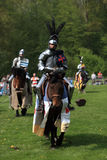 Knigths. Harcourt, France- April 17th, 2011:Image of three medieval knights on the battle field during a tournament held in Harcout in France, to celebrate 1100 Royalty Free Stock Photo