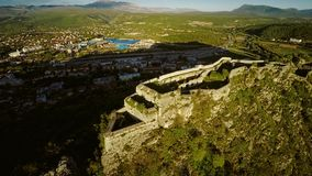Knin Fortress in Croatia. Aerial view of the old military fortress ruins on the hill Spas above the city Knin in Croatia Europe stock video footage