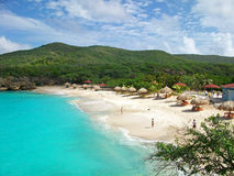 Knip Beach, Curacao. Crystal clear water, bright sand, and lush hillsides of Knip Beach in Curacao royalty free stock image