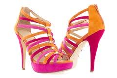 Knip van roze en oranje schoenen stock afbeelding