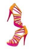 Knip van roze en oranje schoenen, verticaal royalty-vrije stock afbeeldingen