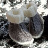 Knit baby booties Stock Photography