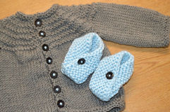 Knit Baby Sweater and Booties Royalty Free Stock Photos