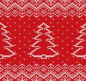 Knit christmas geometric ornament design with fir-trees. Knit christmas geometric ornament design with fir-trees and snowflakes. Xmas seamless pattern. Knitted Royalty Free Stock Photo