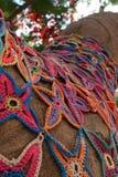 Knit flowers pattern mosaic on tree Stock Photo