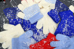 Knit Gloves and Snow Stock Photos