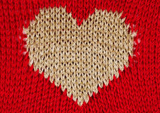 Knit heart golden thread Stock Image