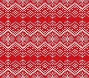 Knit jumper geometric ornament design. Seamless pattern. Knitted winter red color sweater texture. Vector illustration Stock Photo