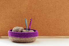 Knit lessons. Knitted baskets crochet note board Royalty Free Stock Photo