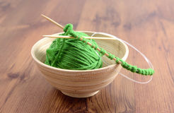Knit needles and wool on table Royalty Free Stock Photos
