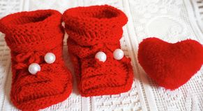Knit newborn baby slippers royalty free stock photography