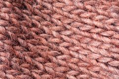 Knit one, purl the next. Pattern knitted from wool brown orange Stock Photography