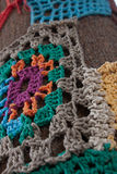 Knit pattern mosaic on tree Stock Photo
