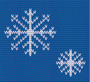 Knit seamless pattern with snowflakes. wool background. vector. Winter theme. Easy to relocate snowflakes Stock Images