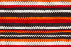 Knit sweater  texture. orange, black and white Stock Image