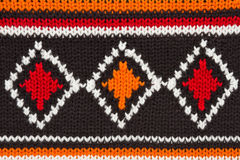 Knit sweater  texture. orange, black, white Stock Image