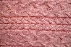 Knit texture of pink wool. Stock Photos