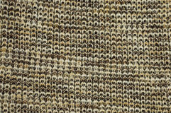 Knit woolen texture. Fabric brown-white background Royalty Free Stock Photo