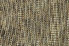 Knit woolen texture. Fabric brown-white background Royalty Free Stock Image
