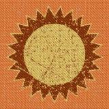 Knit yellow sun symbol seamless pattern texture on orange Stock Photos