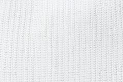 Knitbeschaffenheitshintergrund der weißen Wollmaschenware Stockfotografie