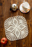Knited openwork crochet doily stock images
