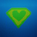 Knited superman icon with Green heart Stock Photos