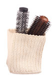 Knited white basket with brushes Royalty Free Stock Images