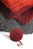 Knits and a ball of wool Royalty Free Stock Images