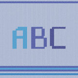 Knitted ABC blue. Knitted fabric with ABC sample Royalty Free Stock Image