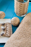 Knitted accessories and yarn balls lying on background Royalty Free Stock Photo