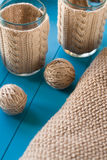 Knitted accessories and yarn balls lying on background Royalty Free Stock Photography